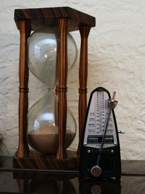 A photo of a wooden metronome.