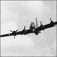 A WW2 Flying Fortress aeroplane powers through the clouds.
