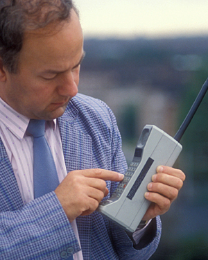 A man using a mobile phone in the early 1980s