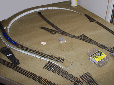 Photograph of a model railway being pinned down.