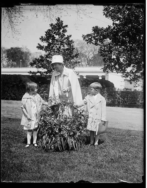 Mrs Calvin Coolidge gets flower at the White House.