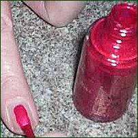 The application of nail polish.
