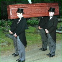 Pallbearers in Victorian dress at Brookwood Cemetery.
