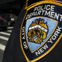 A New York Police Department traffic policeman's badge.