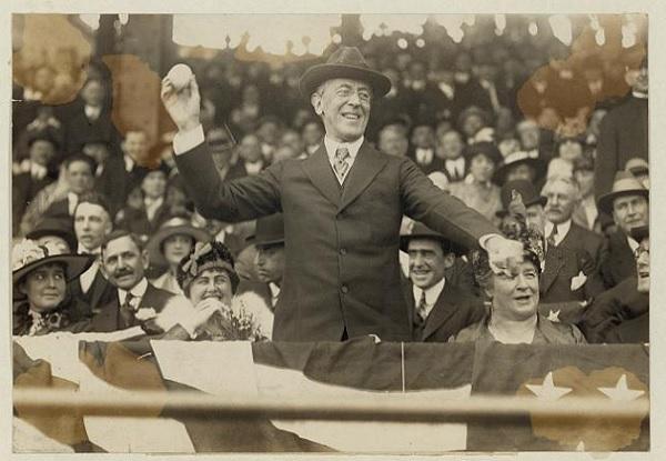 Woodrow Wilson throwing a baseball.