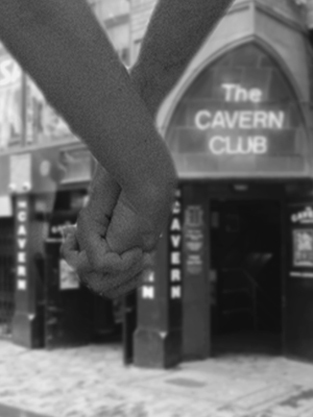 Holding hands outside the Cavern Club, Liverpool.