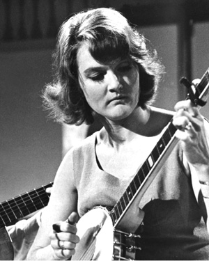 Musician and folk singer Peggy Seeger, playing a banjo in 1966