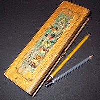 A wooden pencil case.