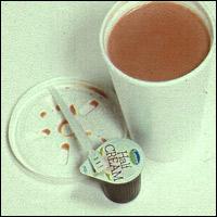 Tea with a plastic stirrer.