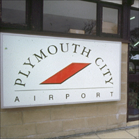 A sign for Plymouth City Airport.