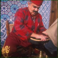 A shoe polisher in action in Turkey.