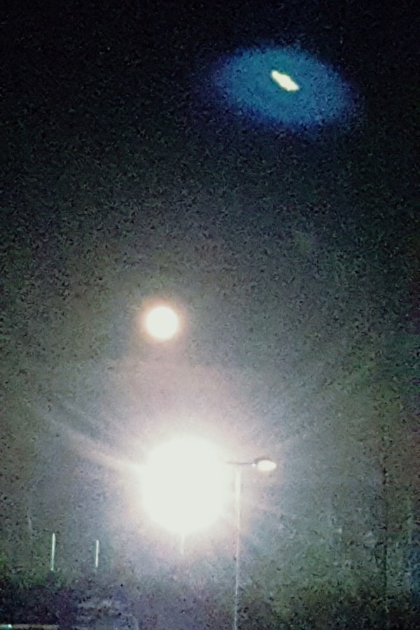The supermoon with a lens flare UFO taken by Cactuscafe from the swimming pool car park'