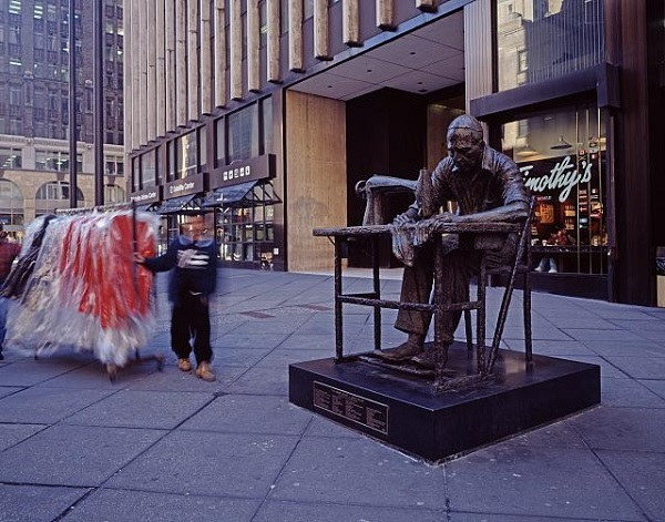 Modern-day statue of a garment worker on 7th Avenue in Manhattan