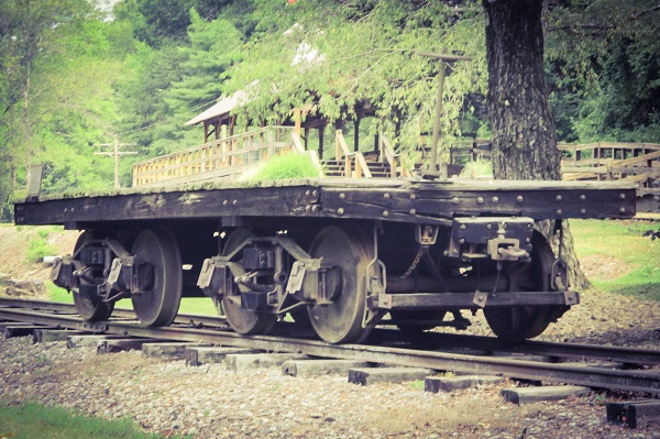 An old freight car on a siding in Titusville in front of the Drake Well Museum, by Dmitri Gheorgheni.