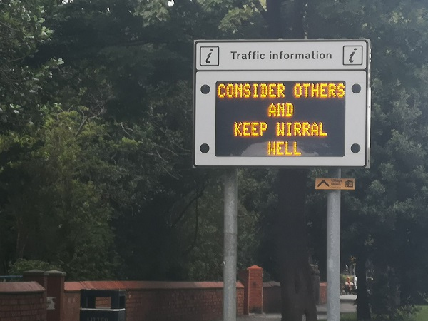 Road sign says Help Keep Wirral Hell. By FWR