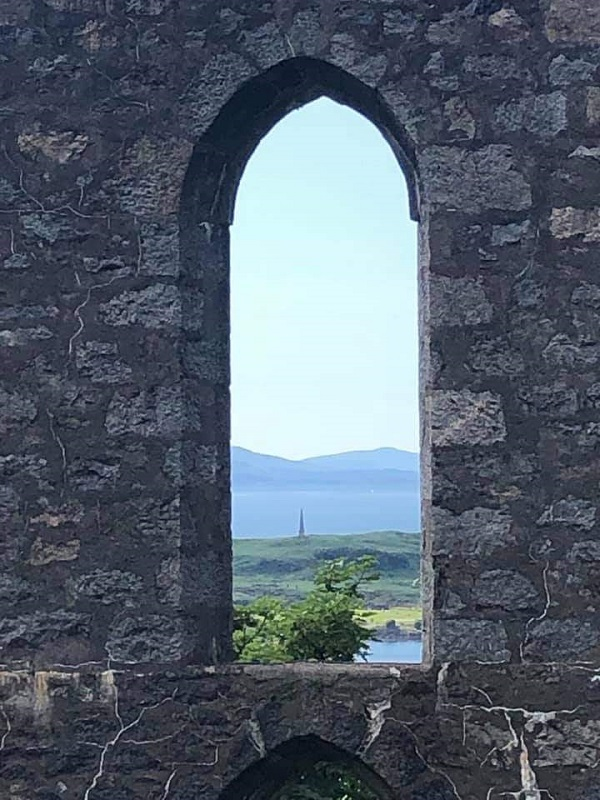 Framed view of a Scottish landscape as seen through an old castle window, by Galaxy Babe's travelling daughter.