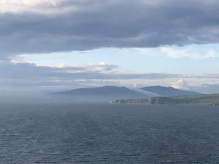 A view from Scotland showing the sea and misty headlands.
