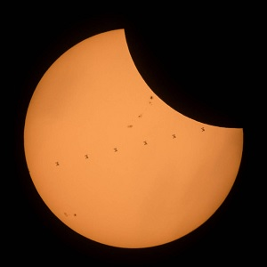 The ISS photobombs the sun during an eclipse.