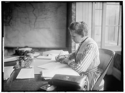 Ida Minerva Tarbell writing at her desk