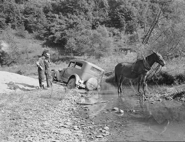 Horse pulling a car out of a stream, from the Library of Congress.