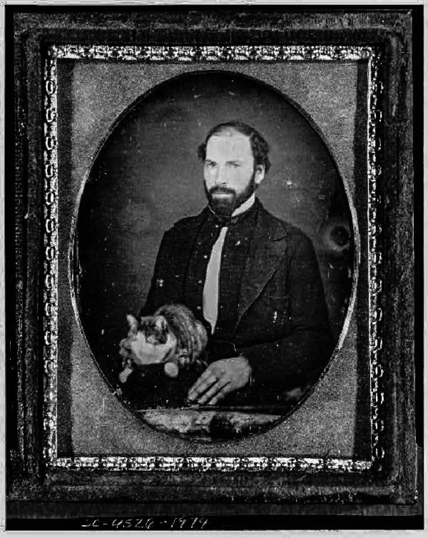 Daguerreotype of a man with a cat.
