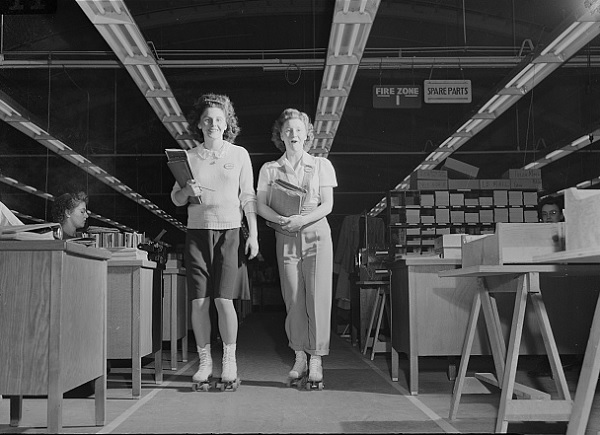 Two young women navigating the Boeing plant on roller skates (not inline) in 1942. From the Library of Congress.