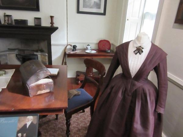 A replica Bronte costume in Mr Bronte's study at Haworth Parsonage