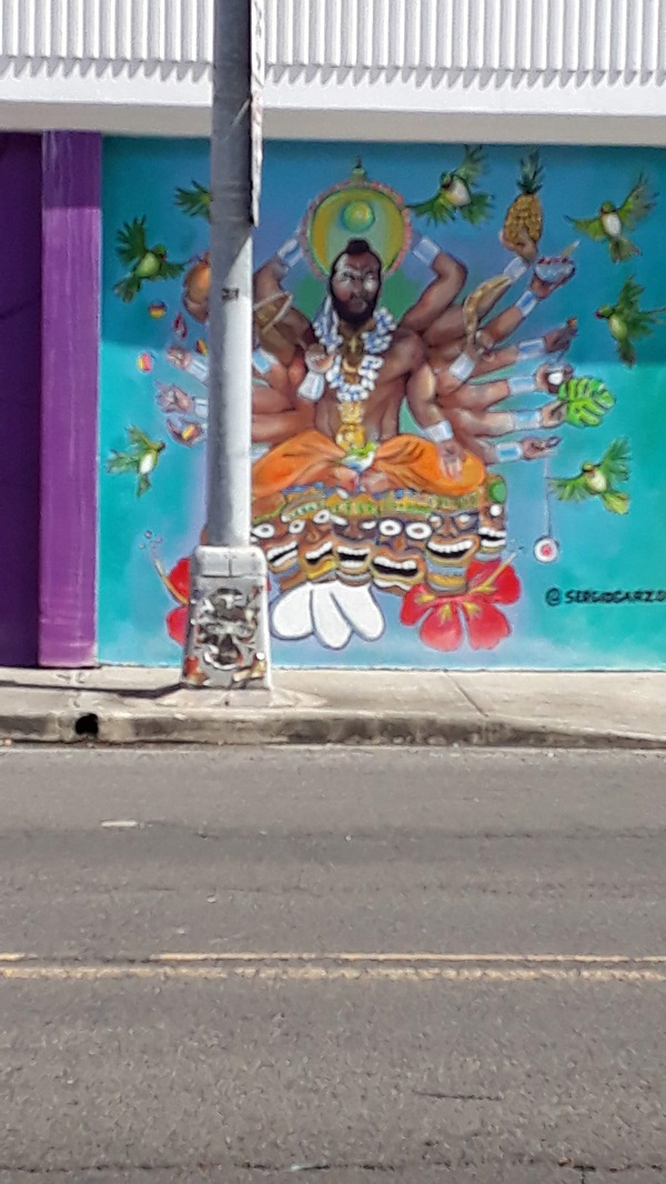 Wall painting of a many-armed deity and colourful birds from Kaka'ako, Honolulu. Photo by Milla.