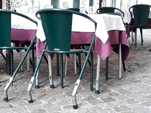 Chairs with insect legs at an outdoor restaurant