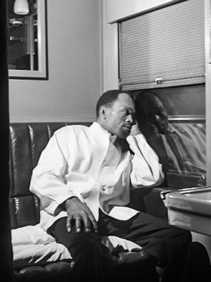 Pullman porter Alfred MacMillan taking a break in 1942. His name is not George.