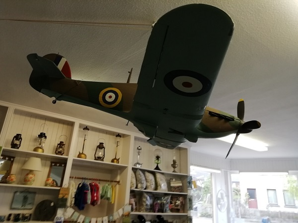 A model Spitfire hanging from the ceiling in the local museum, by Paigetheoracle.
