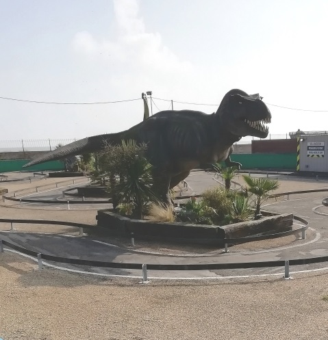 A dinosaur sculpture in Great Yarmouth that is somewhat the worse for wear, by Paigetheoracle.
