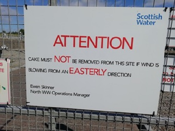 A sign at a water treatment plant in Scotland, warning people not to do their manure cake hauling when the wind is easterly, by Paigetheoracle.