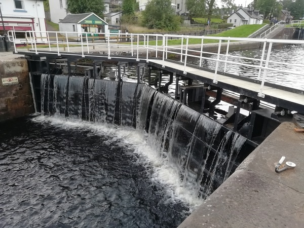 Water falling from a lock, by Paigetheoracle.