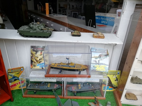 Military display in gift shop, by Paigetheoracle.