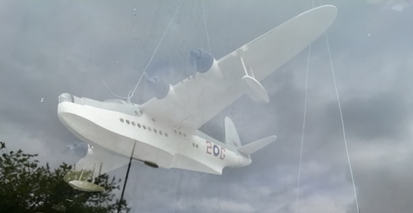 Ghostly plane in a window display at the local heritage centre, by Paigetheoracle.