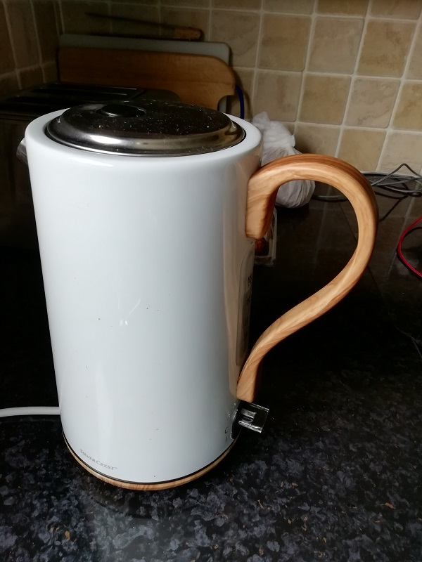 Coffee pot with a handle shaped liked a question mark. Paigetheoracle.