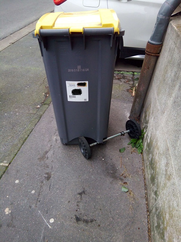 Gruesome Accident by Superfrenchie (damaged wheelie bin)