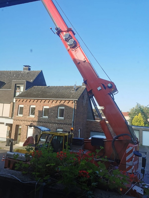 A big red crane towering over Sho's house.