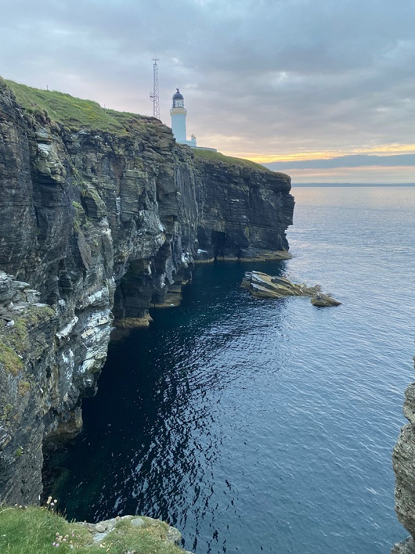Woolly Mammoth's lighthouse, sighted along with the sea and rocky cliffs.