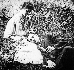 A couple in the grass.