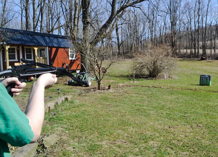 Firing a Crossbow by Dmitri Gheorgheni