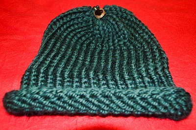 A hat knitted on a round loom.