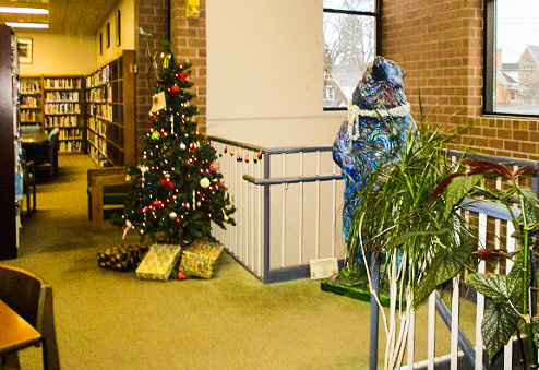Christmas tree in library with bear