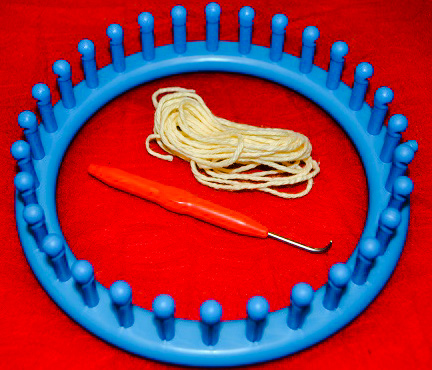 A loom and hook for making knitted things.