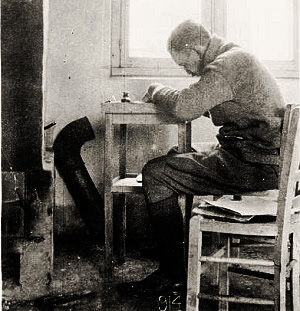 Many writing by a window