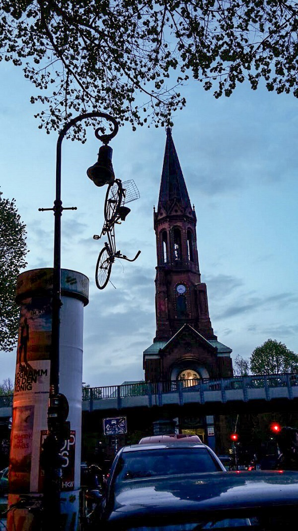A bicycle hanging from a lamppost in Berlin.