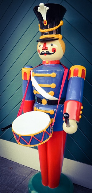 A drummer guards the print shop these days.