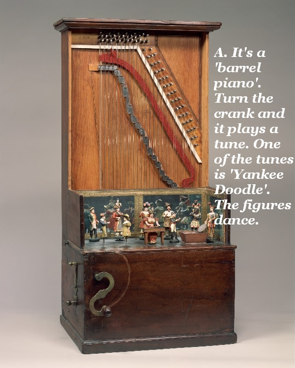 This barrel piano plays several tunes, including Yankee Doodle, when you turn the crank. The figures also dance.