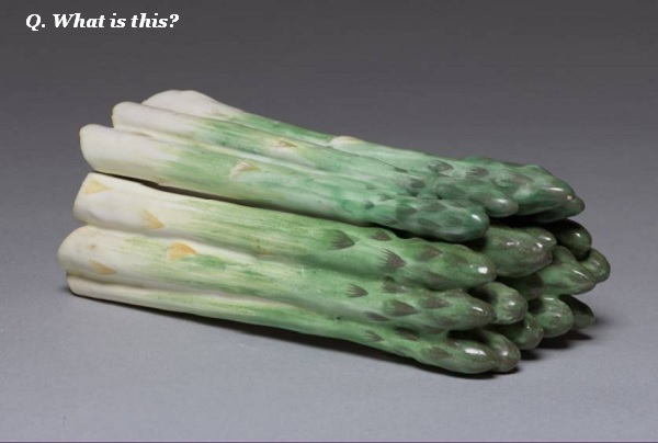 Guess what this asparagus-shaped ceramic doo-dah is for.
